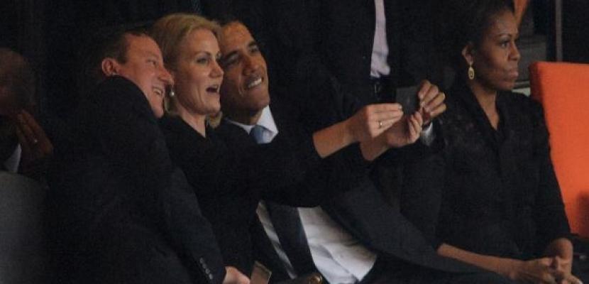 أوباما يتبادل الإبتسامات مع الجارة الشقراء .. ويشعل غيرة زوجته