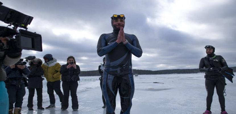فرنسى يحطم الرقم القياسى للسباحة تحت الجليد لمسافة 175 مترًا