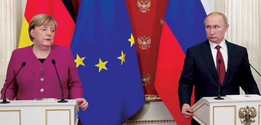 بوتين وميركل يعربان عن القلق من نزاع شرق أوكرانيا